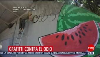 Artista callejero lucha contra pintas de odio en Italia