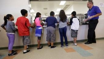 Foto: Niños migrantes hacen fila a la espera de alimentos en Karnes, Texas, EEUU. El 10 de septiembre de 2014