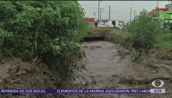 Se desborda río 'El Jaral' en Mexicaltzingo, Toluca