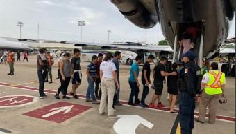 Foto. traslado de migrantes a Honduras, 13 de junio 2019. Twitter @INAMI_mx