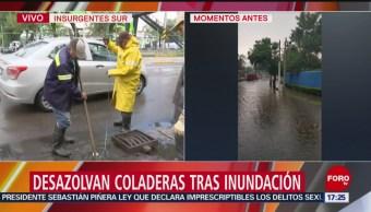 FOTO: Desazolvan coladeras tras inundación en Insurgentes Sur