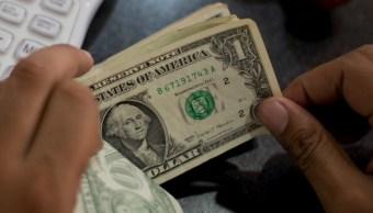FOTO Dólar sigue a la baja, se vende 19.39 pesos (AP mayo 2019)
