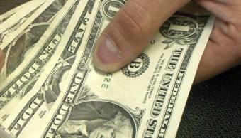 FOTO Dólar baja, se vende hasta en 19.36 pesos (AP, archivo)