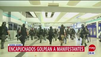 Encapuchados agreden a manifestantes en Hong Kong
