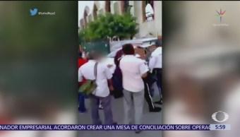 Mujer policía pelea con alumna de secundaria en Zacatepec, Morelos