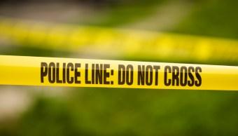policia lines del crimen.