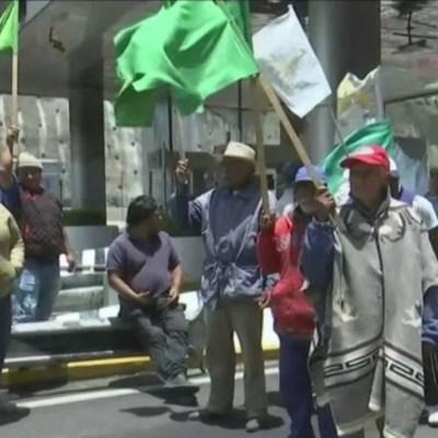 Enfrentamiento entre manifestantes y empleados de la autopista México-Toluca