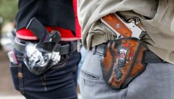Foto: Dos hombres portan armas. Getty Images/Archivo