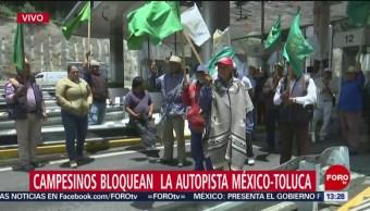 FOTO: Se enfrentan manifestantes autopista México-Toluca