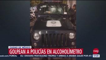 Arrestan a 9 por agredir a policías en punto de alcoholímetro