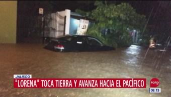 Huracán 'Lorena' toca tierra al este-noreste de Playa Pérula, Jalisco