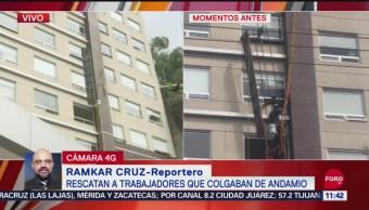 Rescatan a trabajadores que colgaban de andamio en CDMX