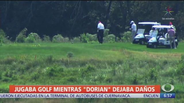 Trump juega golf mientras 'Dorian' se acerca a EU