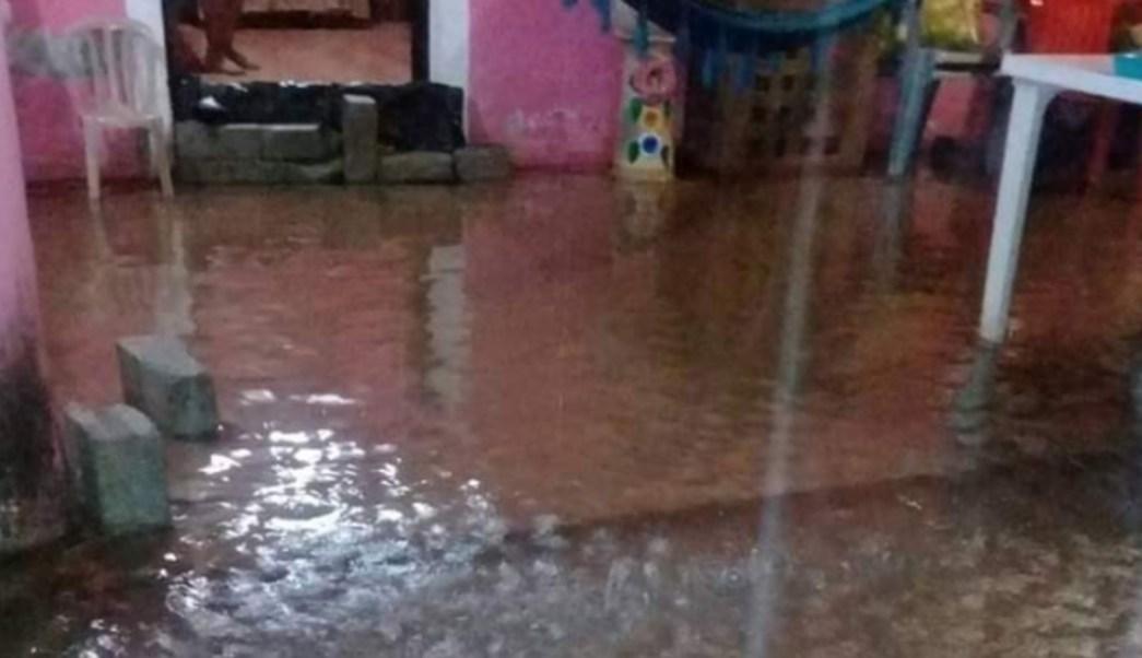 FOTO Lluvia desborda ríos y daña viviendas en Oaxaca (Twitter Alerta Oaxaca)
