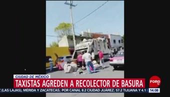 FOTO: Taxistas golpean a recolector de basura en la Miguel Hidalgo, 13 octubre 2019