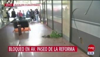 Manifestantes causan destrozos en empresa inmobiliaria