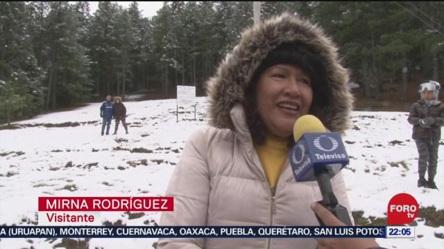 FOTO: 22 diciembre 2019, habitantes de coahuila disfrutan jugar en la nieve