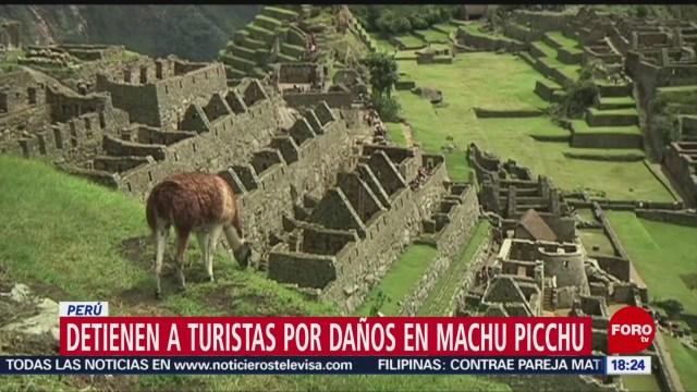 FOTO: detienen a turistas por danos en machu picchu