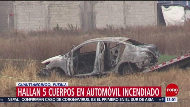 FOTO: hallan cinco cuerpos calcinados en automovil en puebla