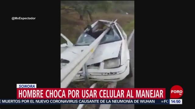 FOTO: hombre choca por usar su celular mientras manejaba