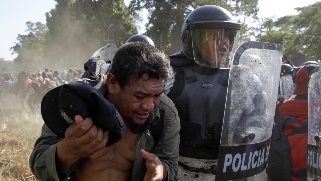 Foto: Guardia Nacional agrede a migrantes. Reuters