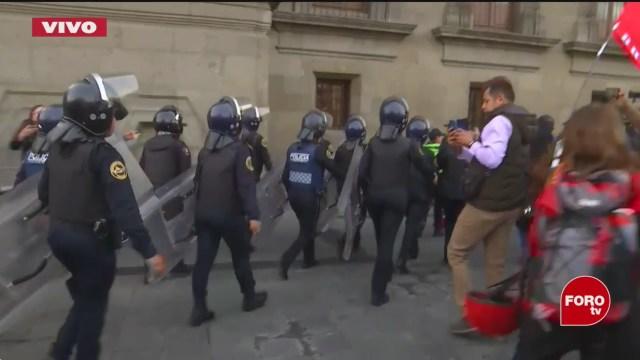 cuerpo antimotines resguardan palacio nacional por protesta de feministas