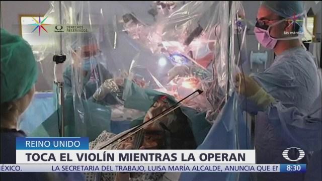 mujer toca violin mientras le extirpan tumor cerebral