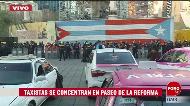 policias capitalinos resguardan angel de la independencia por protesta de taxistas