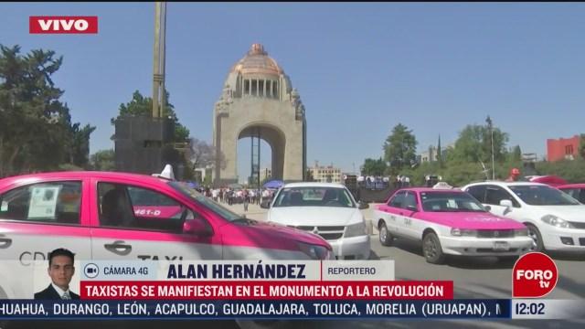 taxistas realizan mitin en el monumento a la revolucion cdmx