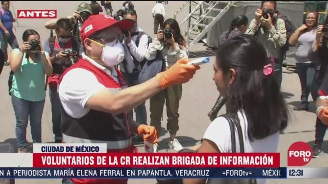 voluntarios de la cruz roja realizan brigadas de informacion