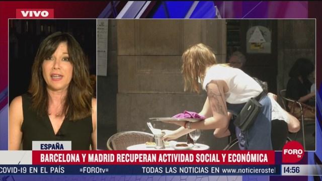 FOTO: barcelona y madrid recuperan actividades social y economica