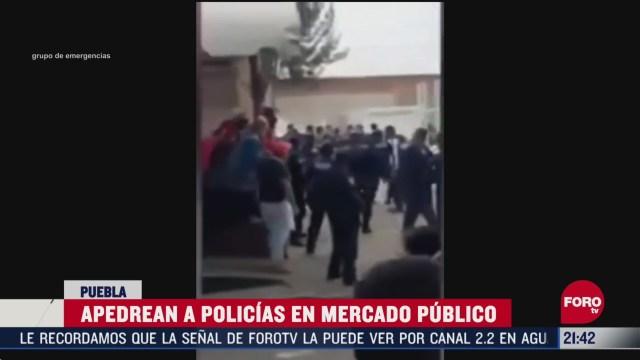 apedrean a policias en mercado de puebla