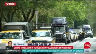 gruas trasladan vehiculos involucrados en atentado contra garcia harfuch