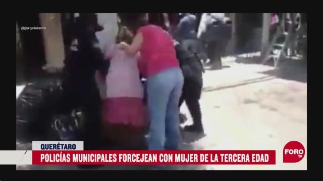 FOTO: intentan detener a adulta mayor y a su hija por no usar cubrebocas en queretaro