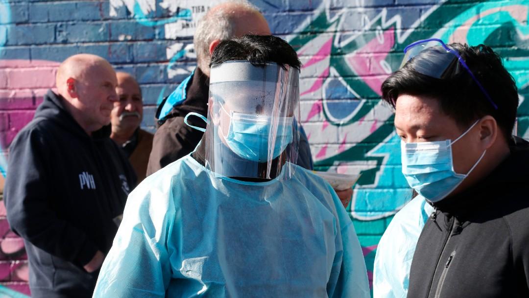 Personas con cubrebocas en Australia, coronavirus