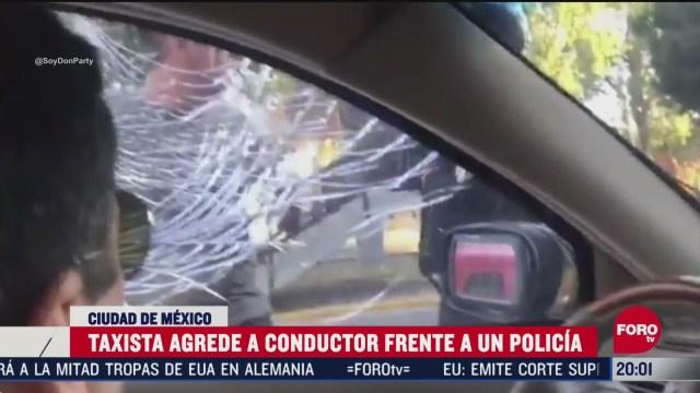 video taxista agrede a conductor frente policia CDMX