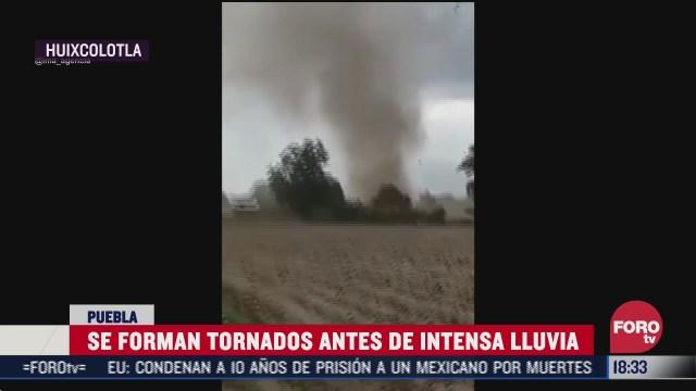 captan formacion de dos tornados en puebla
