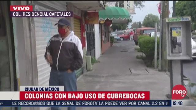 habitante de la CDMX usando cubrebocas por pandemia de coronavirus