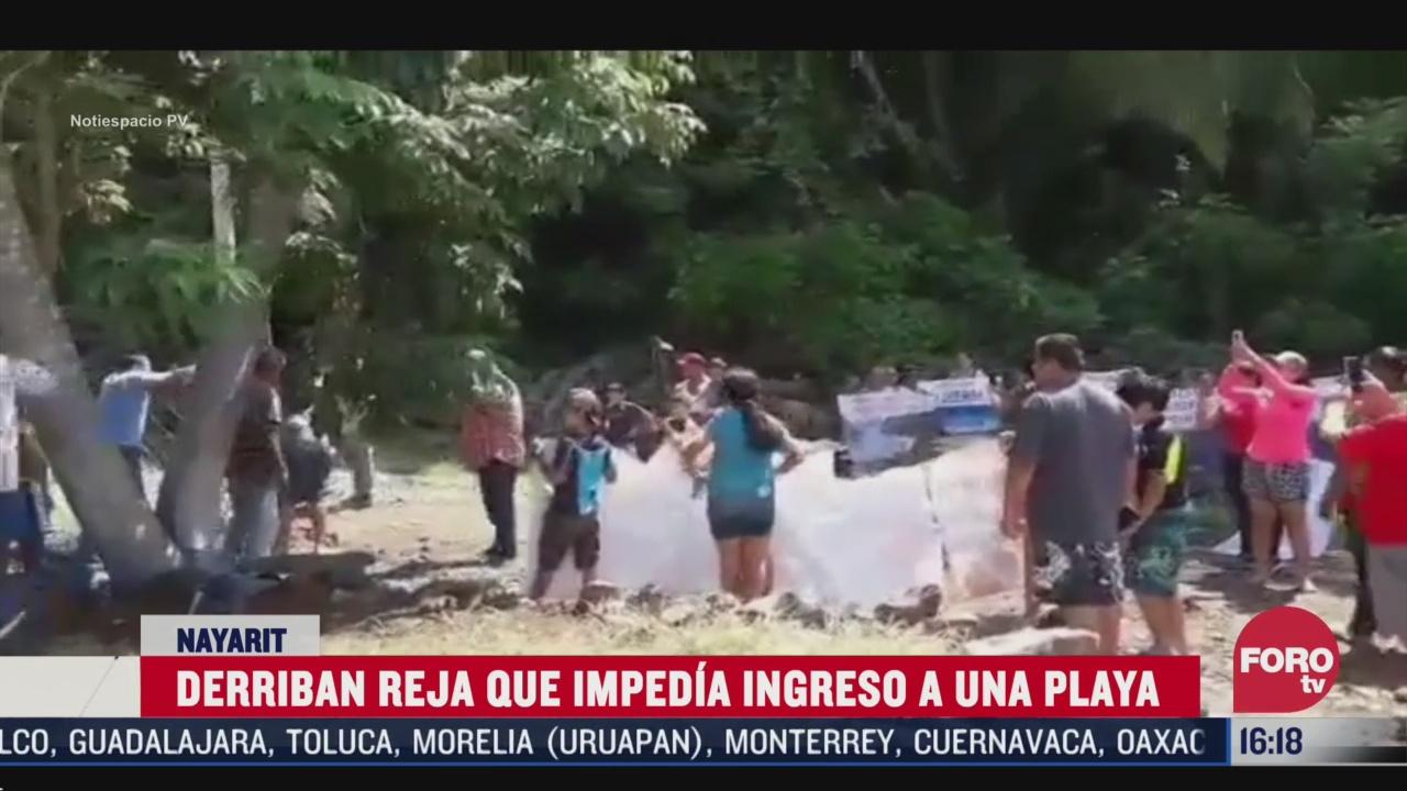 derriban puerta que bloqueaba acceso a playa en nayarit