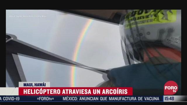 el impresionante momento en que un helicoptero atraviesa un arcoiris