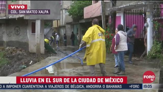 suman 200 casas afectadas por desbordamiento del rio santigo en cdmx continuaran las labores de limpieza