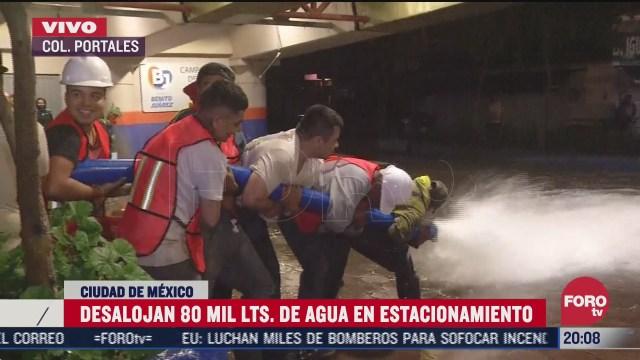 desalojan agua de estacionamiento inundado en colonia portales cdmx