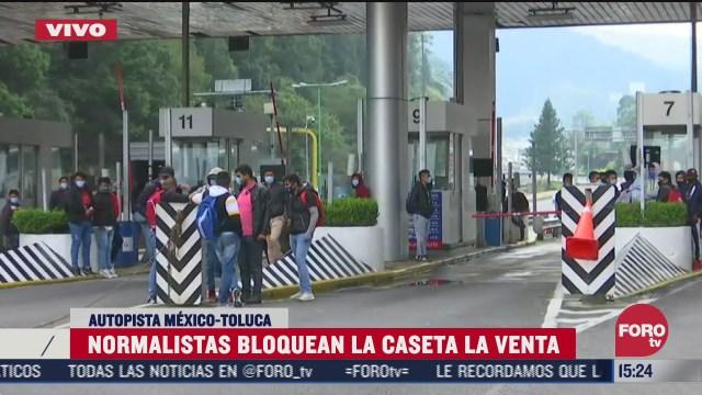 normalistas bloquean la autopista mexico toluca en ambos sentidos