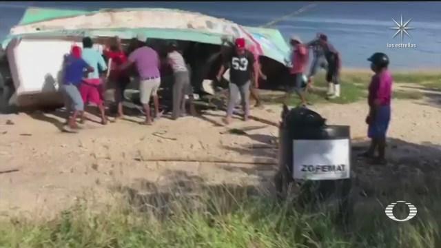 pescadores de campeche se enfrentan con palos y piedras