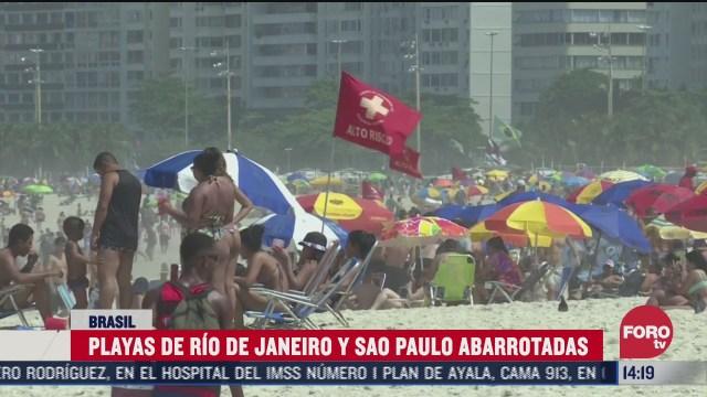 pese a coronavirus saturan playas en brasil