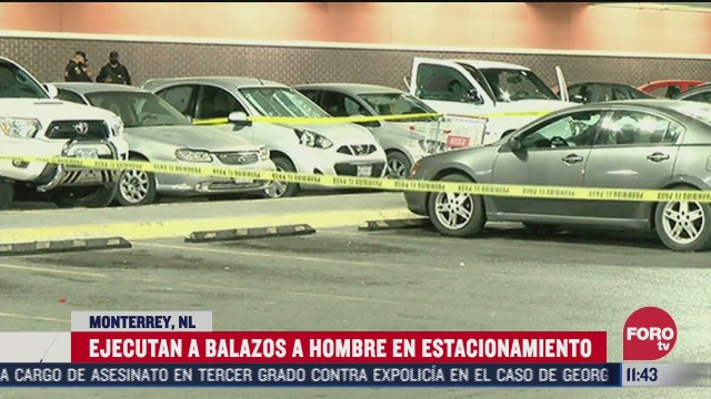 ejecutan a balazos a hombre en estacionamiento