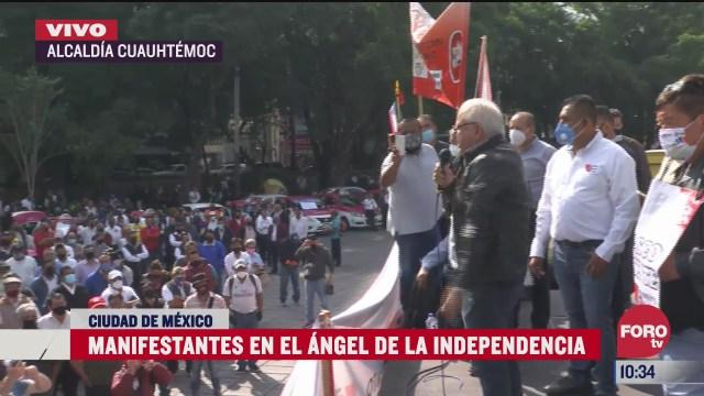 taxistas se manifiestan en el angel de la independencia