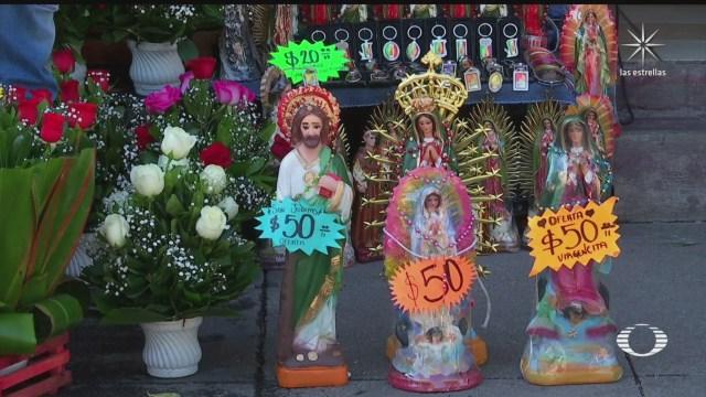 comerciantes de la basilica rematan imagenes por la falta de ventas