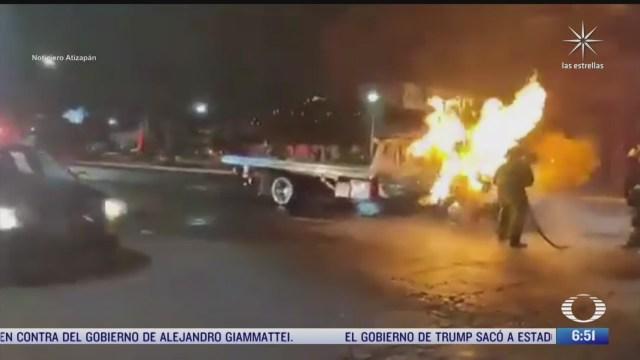 enfrentamiento de transportistas deja tres gruas quemadas en edomex