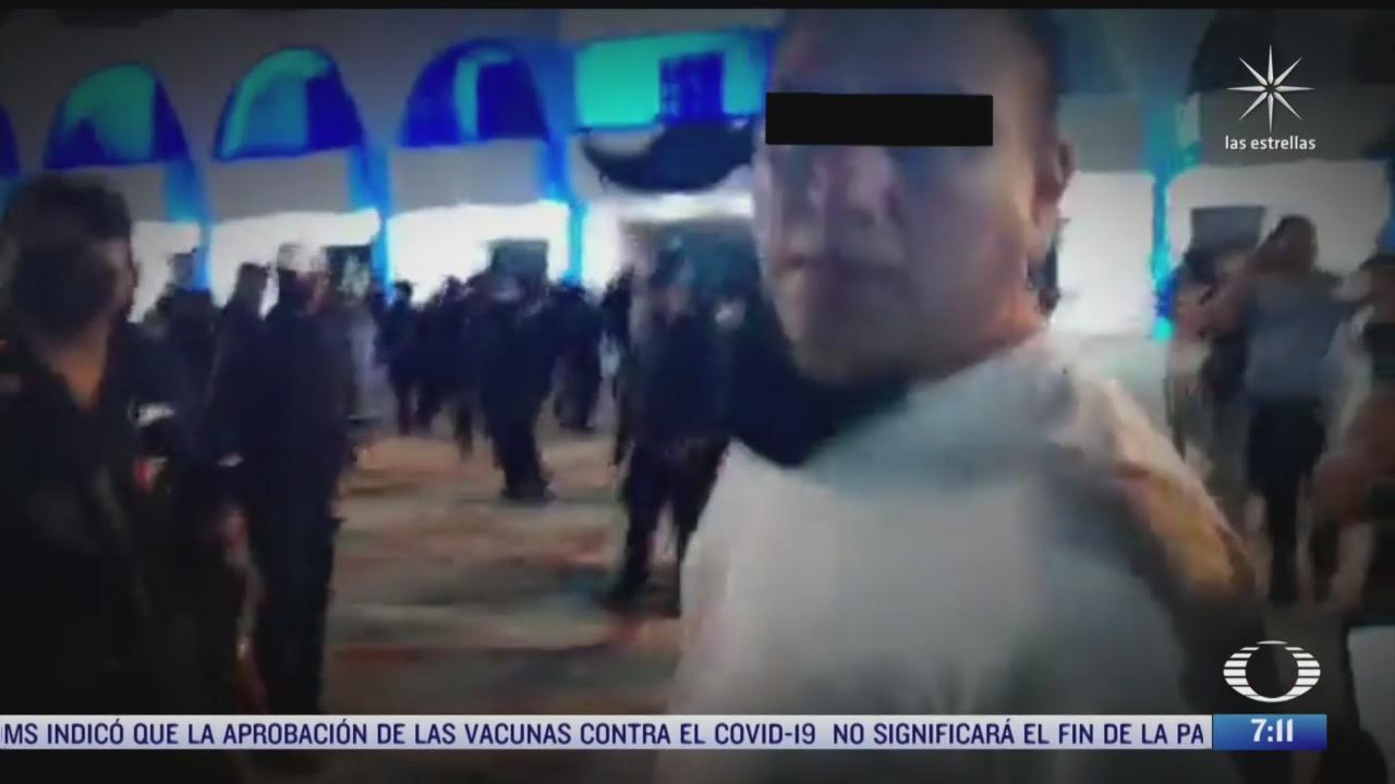 identifican a policia que disparo vestido de civil contra manifestantes en cancun
